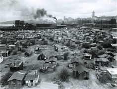 """Hoovervilles , Seattle Washington  """"Hooverville"""" became a common term for shacktowns and homeless encampments during the Great Depression. There were dozens in Washington, hundreds throughout the country, due to the housing and employment crisis of the 1930s. Seattle's main Hooverville was one of the largest, longest-lasting, and best documented in the nation. It stood for ten years, 1931 to 1941."""