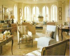Love the pattern chairs, multiple seating area arrangement. Love, love, love.