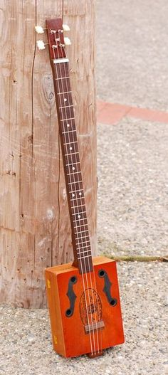 Cigar Box Guitar - tutorial -- how fun is that!? Great craft for the older girls!
