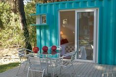shipping container bedroom with sliding doors and a deck