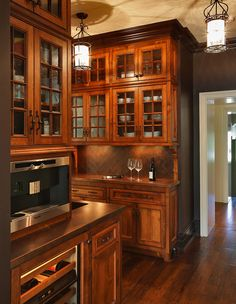 I don't actually like this kitchen -- it looks like a Home Depot model. But the wood and the style of the cabinets remind me of our house.
