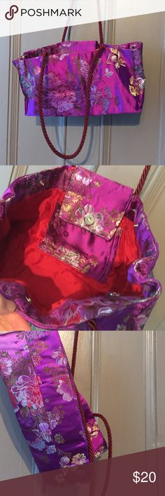 Asian Inspired Satin Handbag Asian style handbag is handmade with enchanting Violet cerise satin. FULLY lined with red fabric. Handbag has a inside pocket and 3 magnetic clasps. Durable enough to carry bottle water and many other things along your journey. Whimsical purple background with flowers. Easy-to-wear over the shoulder or carry. Vintage Bags Satchels