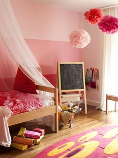 Now: Pink Update  Balancing girly with mod, a child's room is decked out in multiple shades of pink (including a three-tone striped wall), retro motifs, and clean, contemporary lines. The oak furniture and flooring repeat a finish seen in the living space, to unite both areas.