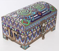Russian silver enameled hinged box. Vividly enameled throughout with scrolled and floral design. Handled to sides. Has hinged flap for lock to front. Gold wash interior. Has town marks and 84 silver purity marks to bottom. Also holds Faberge and double eagle mark to bottom. Holds A.C. assayer mark with M. F. Sokolov Cyrillic MC workmaster marks.