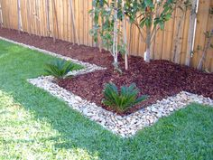 Red Wood Chips and Stones for the Front Hedge
