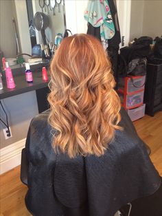 Soft blonde highlights on natural red hair with beach waves!