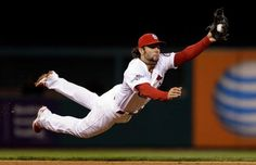 St. Louis Cardinals shortstop Pete Kozma makes a diving catch of a ball hit by Pittsburgh Pirates' Neil Walker in the fourth inning of Game 5 of a National League baseball division series, Wednesday, Oct. 9, 2013, in St. Louis. Photo: Jeff Roberson, AP / AP