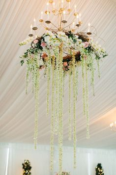 A chandelier streaming with orchids and romantic tendrils instantly creates a dreamy atmosphere.