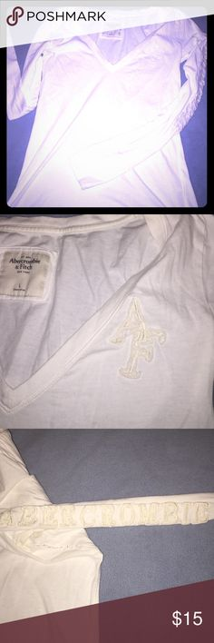 A&F long sleeve white tee. Size L Large white long sleeve Abercrombie & Fitch tee. V neck. AF on left chest region. Abercrombie spelled out on left sleeve. No signs of wear and tear. Pet and smoke free home. Abercrombie & Fitch Tops Tees - Long Sleeve