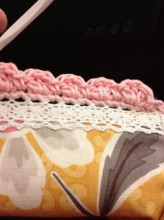 crocheted edging attached to lace