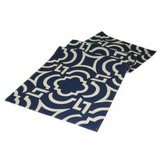 Indoor/outdoor table runner with quatrefoil motif. Made in the USA.   Product: Table runnerConstruction Material: Poly...
