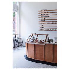 Coffee Shop Menu Board. Pastry Case. Black & White Penny Tile.