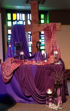 GAUMC Worship Center Lenten Altar 2014 Floating candles, different tones & shades of purple, rough cross