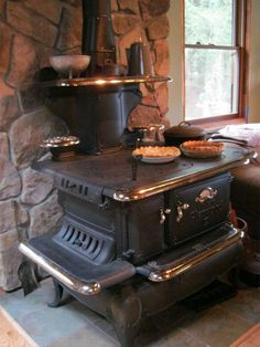 Here are a few examples of Ginger Creek Antique Stoves' satisfied customers creating a perfect historic centerpiece for their homes from our fully functional restored stoves. Antique Kitchen Stoves, Antique Wood Stove, How To Antique Wood, Rustic Kitchen, Vintage Kitchen, Kitchen Decor, Wood Burning Cook Stove, Wood Stove Cooking, Cooking Pork