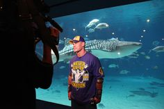 WWE superstar John Cena visits the world's largest aquarium for a special Make-A-Wish project.