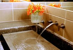 Concrete Countertops - faucet pouring over concrete pad, awesome rock or other object before draining below