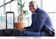 handsome african american businessman waiting in airport