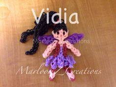 Rainbow loom VIDIA from Tinkerbell - VIDIA is a Combination of My Rhythmic Gymnast Tutorial Only the Colors changed to create Vidia and I also Changed her hair to Curly instead of in a Bun... As for Vidia's (WINGS) You can use My Abby Cadabby's tutorial and use her Wings