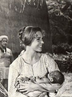 """Candid photo of of Julie Andrews holding baby (in costume as Jerusha Bromley) on set during the filming of """"HAWAII"""" (United Artists, Directed by George Roy Hill English Actresses, Actors & Actresses, Julie Andrews Movies, George Roy Hill, Hawaiian People, The Borgias, Holding Baby, Vampire Academy, Chronicles Of Narnia"""