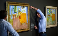 """Bedroom in Arles"", painted by Dutch master Vincent Van Gogh, is put on display next to another version of the same painting, at the Van Gog..."