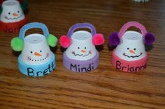 mini clay pots, pipe cleaners, pompoms, and paint.