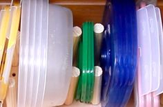 Here's a video showing you how:   Here's A Tupperware Organizer For When Your Kitchen Gets Cluttered