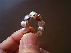Ring of carved Pearl Skulls | SHINJI NAKABA