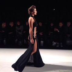Stephan Caras black dress, accented by pearls.