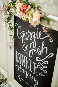 Hand lettered wedding chalk board with trailing Jasmine