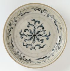 Plate, Vietnam, 15th-16th century. Stoneware with cream slip, underglaze blue painted decoration, and clear glaze. Height: 2 1/4 in. (5.72 cm); Diameter: 9 7/16 in. (23.97 cm). Los Angeles County Museum of Art, Gift of Ambassador and Mrs. Edward E. Masters (M.84.213.222). Photo © Museum Associates/LACMA