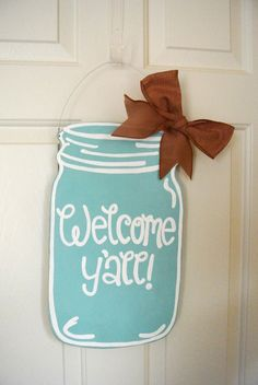 """Welcome Y'all!"" - In true Southern college fashion, why not create a DIY Mason Jar Wooden Sign for your room door? Or purchase it from Etsy.com here. :)"