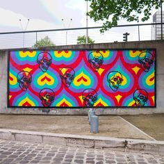 "INSA ""C'est La Vie"" New Mural - Paris, France INSA recently stopped by the beautiful city of Paris in France where he worked on a new animated mural for the Le MUR XIII billboard site. Really loving all the GIFFITI pieces he's been doing lately. The British artist actually re-painting the walls several times to achieve these effects. The wall required 8 layers and 72 skulls over two days of painting."