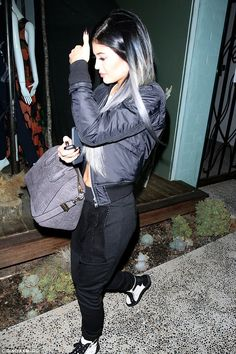 All made up: As she left the mega-appointment, Kylie also revealed claw-like black talons,...