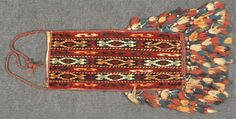 Yomut Igsyalyk (spindle bag) made in Turkmenistan in 1900. 28 x 62 cm + frienge 23 cm (11 in. x 24 in. + frienge 9 in.)