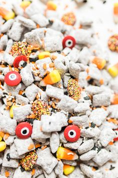 We turned classic - and delicious - Muddy Buddies; a.k.a., Puppy Chow, into a spooky treat; the perfect dessert for your next haunted Halloween party! Click through for the recipe. #halloween #halloweendessert #halloweencandy #halloweentreat #puppychow #halloweenpuppychow #muddybuddies #halloweenmuddybuddies | glitterinc.com | @glitterinc Halloween Treats To Make, Halloween Puppy, Halloween Drinks, Halloween Desserts, Halloween Food For Party, Haunted Halloween, Halloween Activities, Halloween Ideas, Holiday Activities