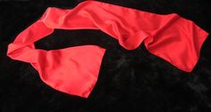 Red sueded charmeuse silk scarf. A truly sumptuous scarf. Bomber jacket scarf or formal wear opera scarf.  Le Beau Cous most popular selling scarf.  #red #formalwear #scarf #silkscarf #aviatorscarf #gentlemensattire #silk #tuxedoscarf #motorcyclescarf #bomberjacket  #skinnyscarf #lebeaucou