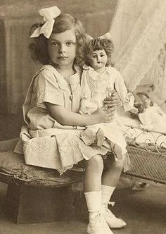 Antique photo girl with doll