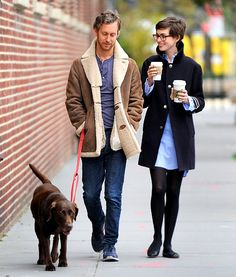 A just-married Anne Hathaway steps out with her hunny in oversized geek chic specs during a romantic stroll