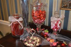 Candy buffet looked pretty in hurricane or glass candy jars