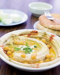 """Before opening Zahav restaurant in Philadelphia, chef Michael Solomonov visited hummus parlors all over Israel trying to find the best recipe. """"Hummus is the hardest thing to get right,"""" he says. """"It has to be rich, creamy and mildly nutty."""" To make his hummus luxuriously smooth, he soaks the chickpeas overnight with baking soda to soften them."""