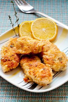 Recipe including course(s): Entrée; and ingredients: black pepper, chicken breast, dried parsley, garlic powder, Italian bread crumbs, paprika, parmesan cheese