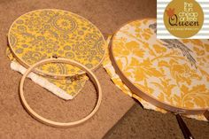 glue the fabric tightly to the inner hoop.  when dry, remove outer embroidery hoop.