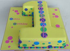 Colourful number one birthday cake. Loved the colours on this cake! It is such a fun cake with the colours and spots :) Find me on Facebook (Driving Me Cakey) for more photos of my work or contact me via e-mail, drivingmecakey@gm... to enquire about an order. Located Fairview Park, South Australia.