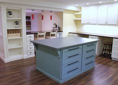 Basement craft room - bright task lighting and built-in customized storage