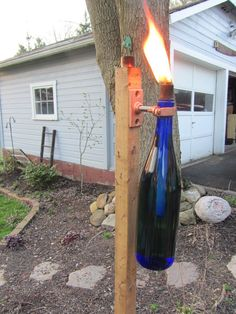 Backyard torch made from old wine bottles.