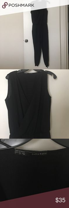 Zara black jumpsuit. Stylish Zara jumpsuit. Deep V opening in front requires a cute bralette or tank underneath. Elastic at ankles. Zara Other
