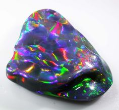 """61.10 cts """"Harlequin"""" Opal---This is about as pretty as I've  seen.     cyeary70@yahoo.com"""