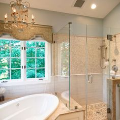 Master Bath exact photo inspiration. Corner oval tub under window with tub deck that continues into shower as seat.