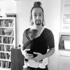 Oh my god, he wears his baby.