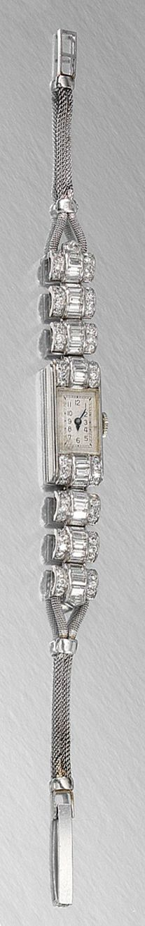 LADY'S DIAMOND DRESS WATCH, ASPREY LONDON, CIRCA 1910.  The rectangular dial decorated with Roman numerals and blued steel hands to arched linked terminals, channel-set with baguette diamonds and single-cut stones, on a corded strap of mesh linking, length approximately 150mm, signed Asprey London and numbered.